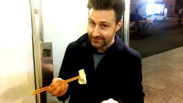 Julian Day in conversation over dumplings